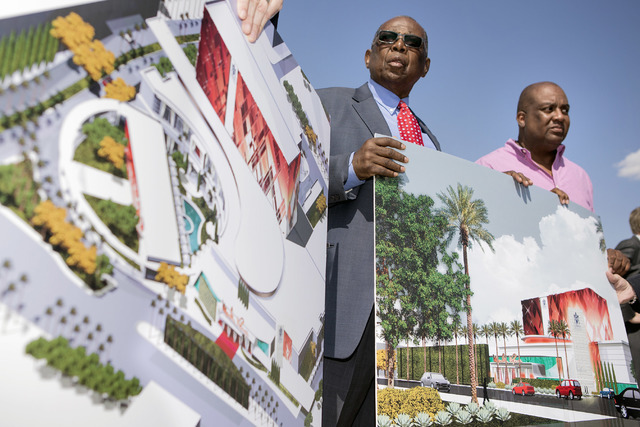 Gene Collins, left, a member of Moulin Rouge Holdings and Scott Johnson, a member of Moulin Rouge Holdings, holds a rendering during a groundbreaking at the original Moulin Rouge site at 900 W. Bo ...