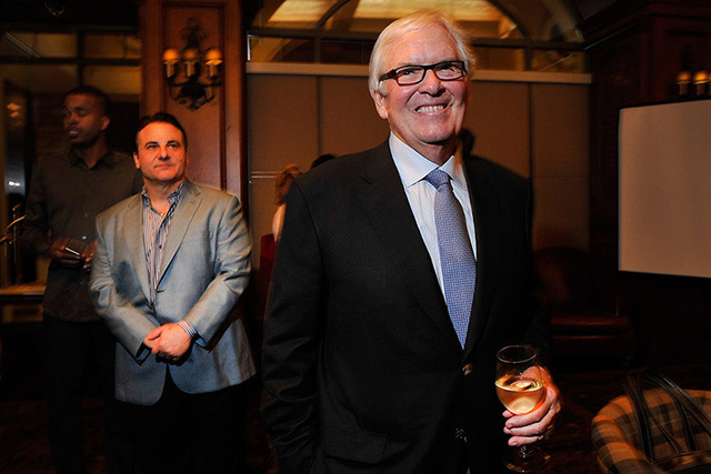 Bill Foley, right, the public face of an ownership group seeking to create an NHL team in Las Vegas, appears during a promotional stop to sell season hockey tickets at the Southern Highlands Golf  ...