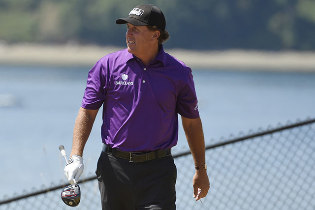 Phil Mickelson walks off the 16th tee in the third round of the 2015 U.S. Open golf tournament at Chambers Bay. (John David Mercer/USA TODAY Sports)