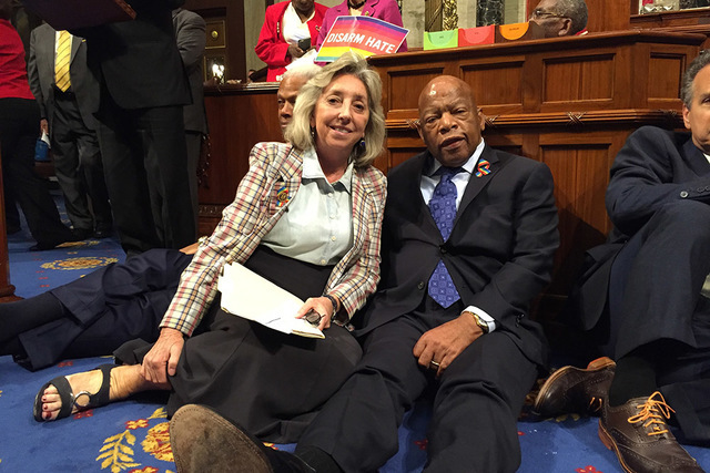 Rep. Dina Titus, D-Nev., sits with Rep. John Lewis, D-Ga., as both participate Wednesday in a sit-in on the House floor that sought to force a vote on gun control measures on Capitol Hill in Washi ...