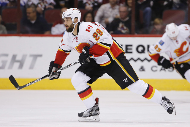 Calgary Flames' Deryk Engelland (29) skates to the puck against the Arizona Coyotes during the first period of an NHL game Friday, Nov. 27, 2015, in Glendale, Ariz. (Ross D. Franklin/AP)