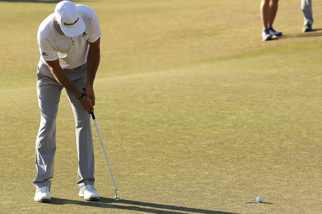 In this June 21, 2015, file photo, Dustin Johnson three-putts on the 18th hole during the final round of the U.S. Open golf tournament at Chambers Bay in University Place, Wash. Johnson lost to Jo ...