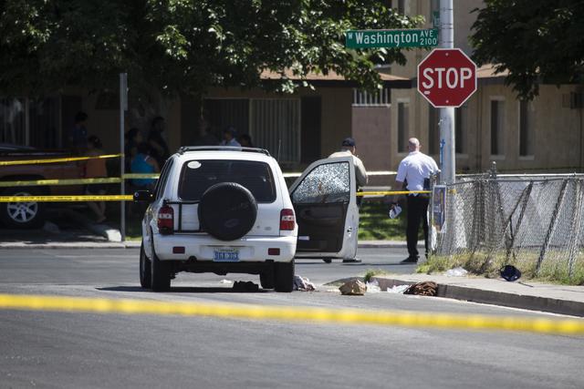 The scene of a shooting near Tonopah Drive and Washington Avenue is seen on Wednesday, June 1, 2016, in Las Vegas. (Erik Verduzco/Las Vegas Review-Journal)