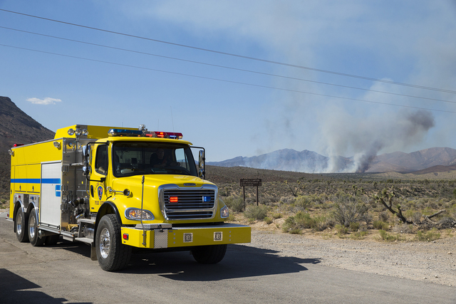 An engine from the Clark County Fire Department leaves the scene of a wildfire near state Route 160 and Lovell Canyon Road on Sunday, June 26, 2016, west of Las Vegas. (Benjamin Hager/Las Vegas Re ...