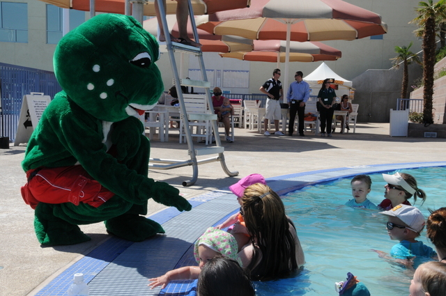 Rad Tad, the city of Henderson's water safety mascot, is seen talking to children during the World's Largest Swimming Lesson in 2011. The next event is planned for June 20 at various locations ...