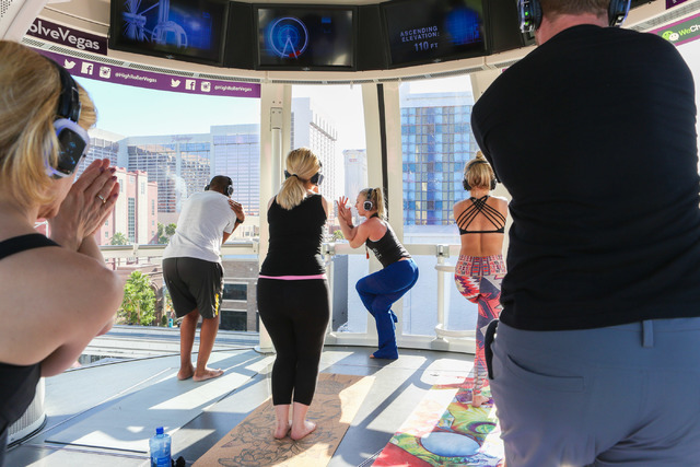 Silent Savasana instructor leads a group of six volunteers in a silent yoga set on the High Roller in Las Vegas, Wednesday, June 15, 2016. (Elizabeth Brumley//Las Vegas Review-Journal) @elipagephoto