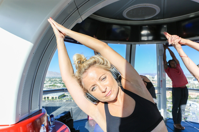 Chelsea Pierce, volunteer, participates in a yoga session led by a Silent Savasana instructor in a silent yoga set on the High Roller in Las Vegas, Wednesday, June 15, 2016. (Elizabeth Brumley//La ...