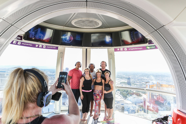 Silent Savasana instructor, Markie Henderson, takes a group photo of the volunteers participating in a silent yoga set on the High Roller in Las Vegas, Wednesday, June 15, 2016. (Elizabeth Brumley ...