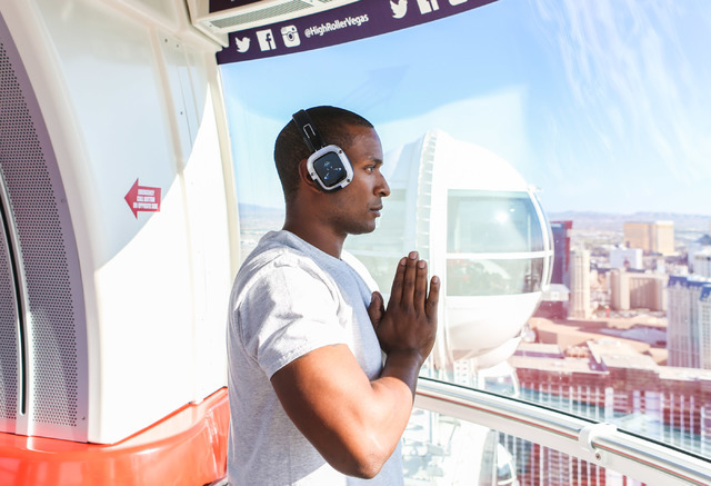 Floyd Hanes, volunteer, participates in a yoga session led by a  Silent Savasana instructor in a silent yoga set on the High Roller in Las Vegas, Wednesday, June 15, 2016. (Elizabeth Brumley//Las  ...