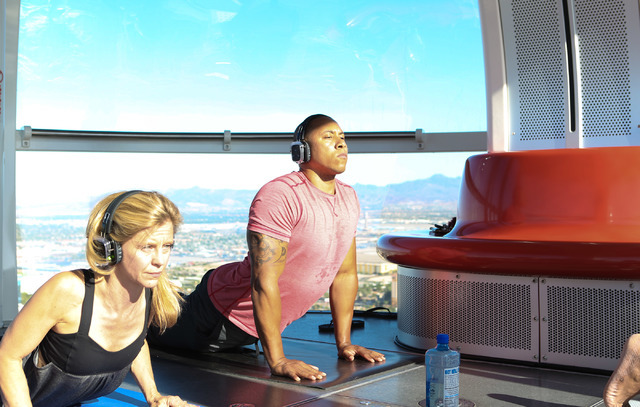 Tony Alexander, volunteer, participates in a yoga session led by a  Silent Savasana instructor in a silent yoga set on the High Roller in Las Vegas, Wednesday, June 15, 2016. (Elizabeth Brumley//L ...