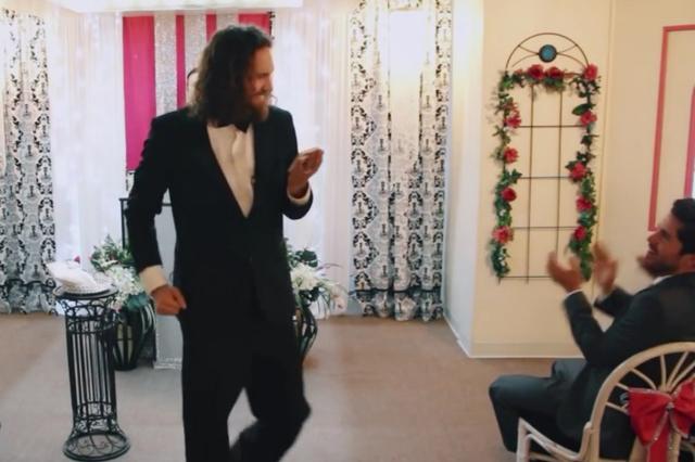 "Aaron Chervenak is all smiles after ""marrying"" his beloved smartphone at Little Vegas Chapel in Las Vegas. (YouTube screenshot)"