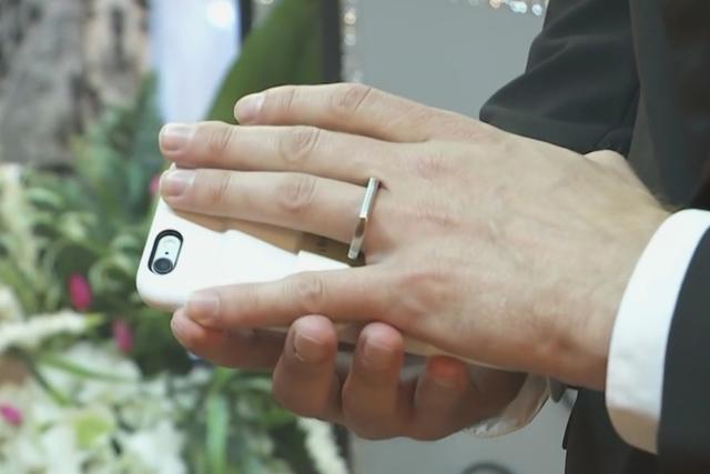 Artist/director Aaron Chervenak and his beloved phone at Little Vegas Chapel in Las Vegas. (YouTube screenshot)