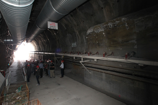 Congressmen's staff, journalists and Department of Energy employees gather in the north portal during a congressional tour of the Yucca Mountain exploratory tunnel Thursday, April 9, 2015. (Sam Mo ...