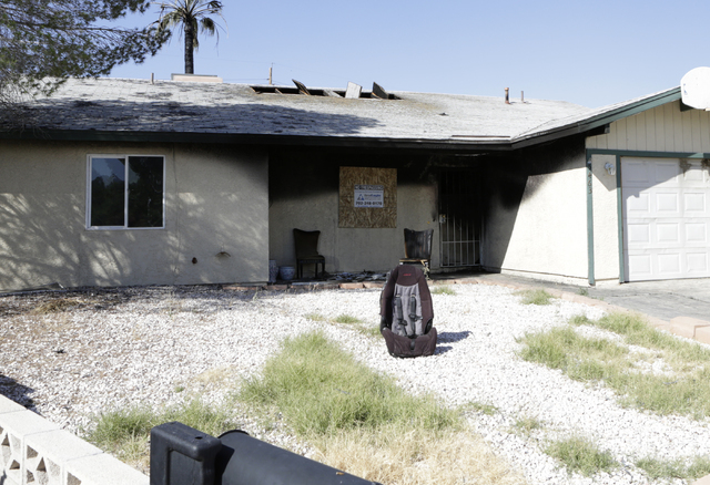 A fire destroyed a home at 5463 Yvonne Circle just after midnight Monday, June 13, 2016. One person was hospitalized and two adults were treated for smoke inhalation. Bizuayehu Tesfaye/Las Vegas R ...