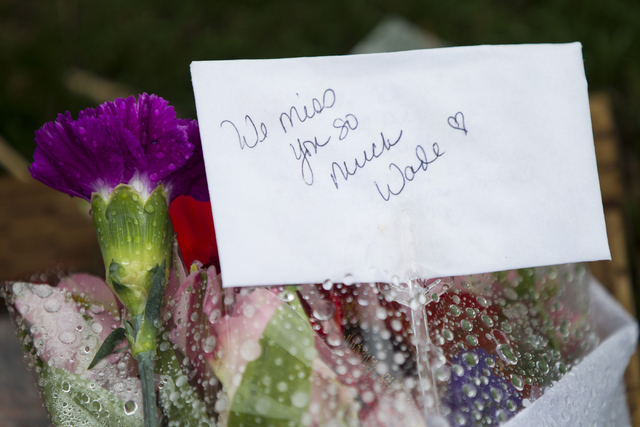 A note is seen on the grave site for one of the 19 members of the Granite Mountain Hotshot crew killed while battling a fire in Yarnell, Ariz. three years ago at the Arizona Pioneers Home Cemetery ...