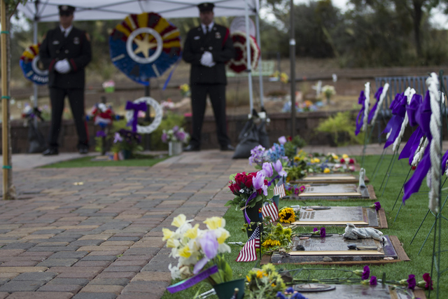The grave site for the 19 members of the Granite Mountain Hotshot crew killed while battling a fire in Yarnell, Ariz. three years ago at the Arizona Pioneers Home Cemetery on Thursday, June 30, 20 ...