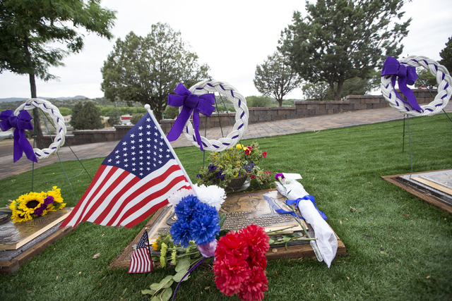 The grave site for the 19 members of the Granite Mountain Hotshot crew killed while battling a fire in Yarnell, Ariz. three years ago is seen at the Arizona Pioneers Home Cemetery on Thursday, Jun ...