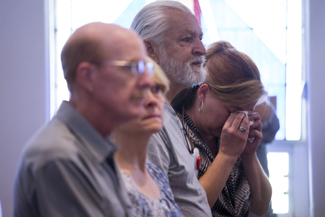Shelly Bacon, right, wipes tears while attending the Third Anniversary Memorial Service of the Yarnell Hill Fire with her friend Chuck Tidey at the Yarnell Community Church on Thursday, June 30, 2 ...