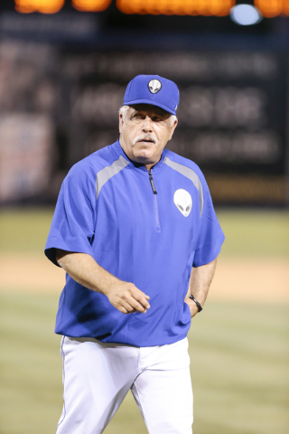 Las Vegas 51s manager Wally Backman walks back to the dugout after making a pitching change in the top of the ninth inning at a baseball game against the Salt Lake Bees at Cashman Field in Las Veg ...