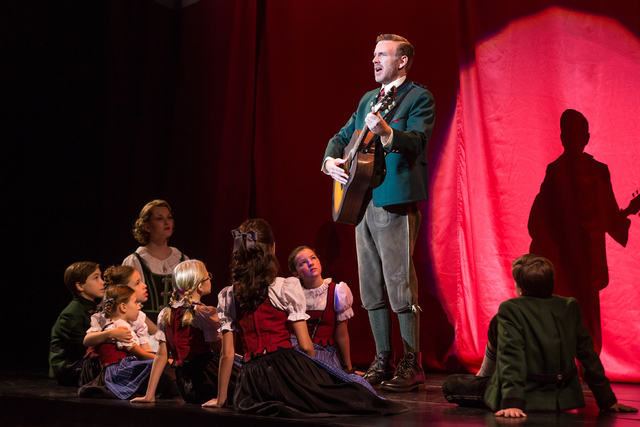 "As Maria and the Von Trapp children look on, Capt. Georg Von Trapp (Ben Davis) performs ""Edelweis"" in the new ""Sound of Music"" tour, opening Tuesday at The Smith Center. MATTHEW MURPHY/COURTESY TH ..."