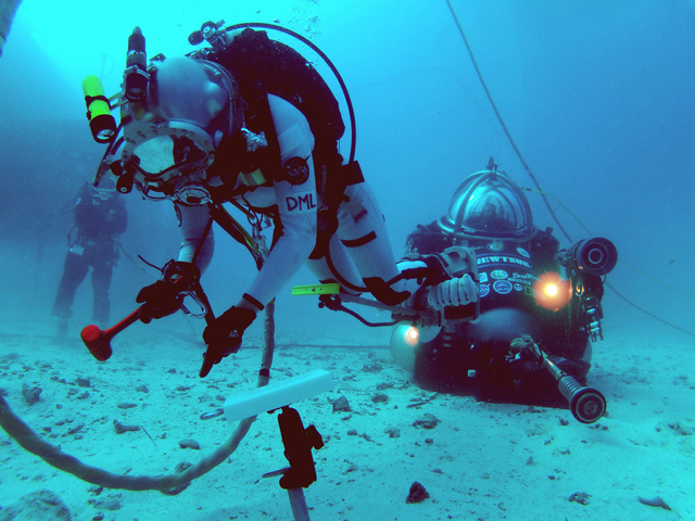 NASA astronauts practice simulated space maneuvers on the ocean floor during NASA Extreme Environment Mission Operations (NEEMO) 16 in 2012. They took a 3-minute Psychomotor Vigilance Task) test t ...