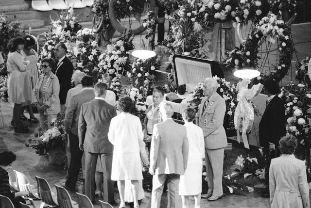 Friends and well-wishers file past the open casket bearing the body of Karl Wallenda who died from a fall during a high-wire act, in San Juan, Puerto Rico, at a wake in Sarasota, Fla., in 1978. (T ...