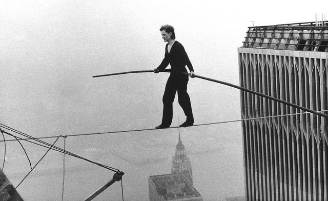 Philippe Petit, a French high wire artist, walks across a tightrope suspended between the World Trade Center's Twin Towers in New York in 1974.  (The Associated Press)