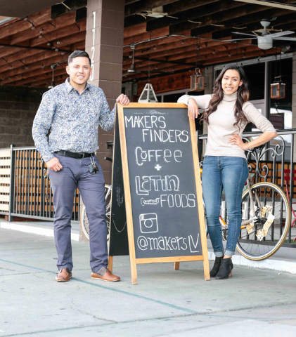 Co-owners Josh Molina, left, and Valeria Varela, pose for a picture next to their sidewalk sign outside of Makers & Finders coffee shop at 1120 S. Main St. #110, Las Vegas, Wednesday, Jan. 6,  ...