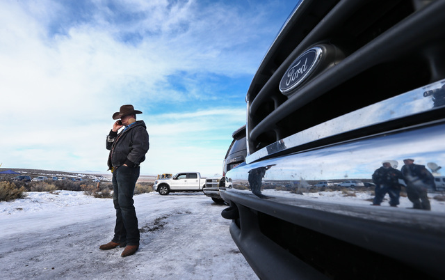 Ryan Bundy takes a phone call by the entrance of Malheur National Wildlife Refuge headquarters near Burns, Ore. on Wednesday, Jan. 6, 2016. (Chase Stevens/Las Vegas Review-Journal) Follow @cssteve ...