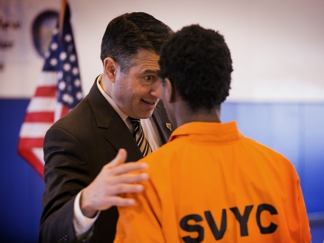 Nevada Gov. Brian Sandoval talks to a juvenile at  the Summit View Youth Correctional Center, a 48-bed  facility in North Las Vegas, on Friday, Feb. 26, 2016. (Jeff Scheid/Las Vegas Review-Journal ...