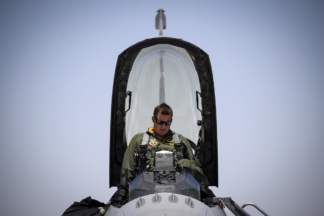 Maj. Kyle Ruthford, an F-16 Fighting Falcon pilot from Shaw Air Force Base's 79th Fighter Squadron, climbs into his jet day 1 of Red Flag, July 11, 2016 at Nellis Air Force Base, Nevada. The exerc ...