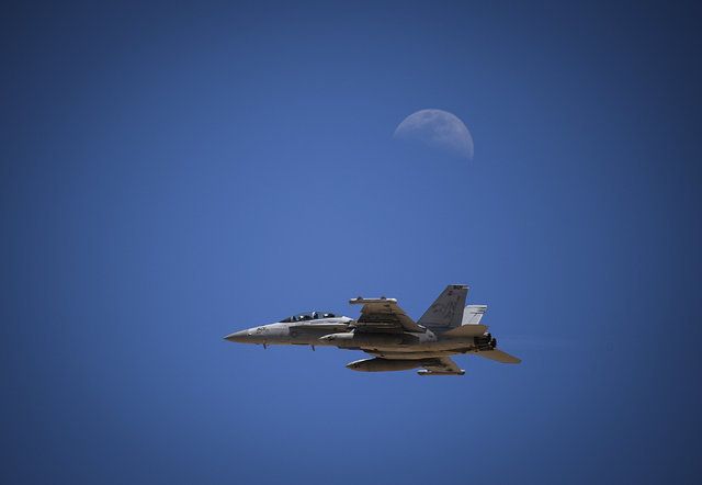 An EA-18G Growler takes off for a training mission as part of Red Flag 16-3 while the moon shines in the background at Nellis Air Force Base, Nevada, July 11, 2016. Red Flag 16-3 is focusing on in ...