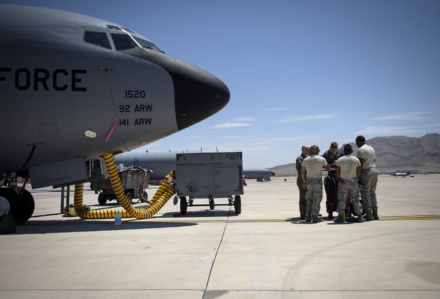 Aircrew and ground personnel conduct a pre-flight check at Nellis Air Force Base, Nevada July 18, 2015 during exercise Red Flag. The aircrew went on to refuel several exercise particapants. (Tech. ...