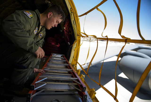 Senior Airman Jordan Webber, a KC-135 Stratotanker boom operator from McDill Air Force Base, double checks gear is where it needs to be shortly before an refueling mission at Nellis Air Force Base ...