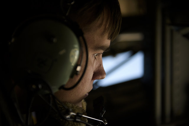 Senior Airman Jordan Webber, a KC-135 Stratotanker boom operator from McDill Air Force Base, refuels an F-22 Raptor from Langley Air Force Base, Virginia during a mission for exercise Red Flag at  ...