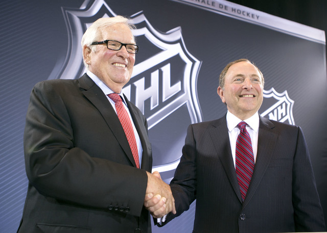 Bill Foley, Las Vegas billionaire businessman and owner of the new National Hockey League expansion team, and commissioner Gary Bettman stand for a photo during a news conference at Encore Las Veg ...