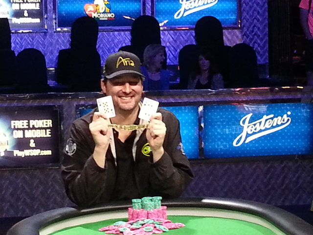 Phil Hellmuth poses with the 10 and 4 of spades to represent his 14th career World Series of Poker bracelet. Hellmuth won the $10,000 buy-in Razz Championship late Monday at the Rio Convention Cen ...