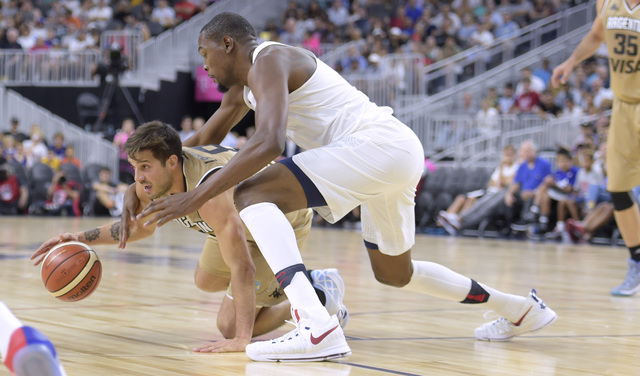Kevin Durant of the United States fights for a loose ball with Nicolas Laprovittola of Argentina during a USA Basketball showcase exhibition game at T-Mobile Arena Friday. (Sam Morris/Las Vegas Ne ...