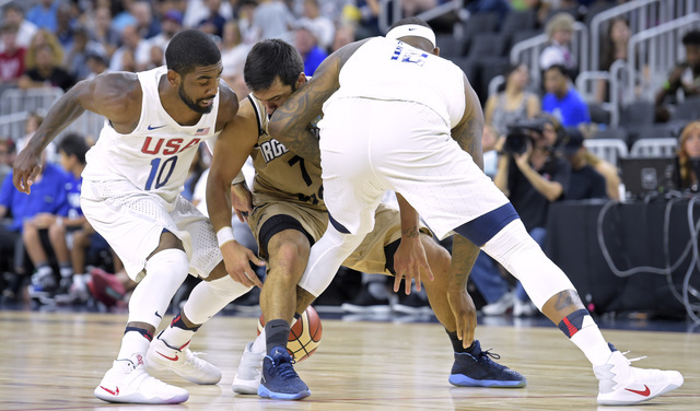 Kyrie Irving, left, and DeMarcus Cousins of the United States forces Facundo Campazzo of Argentina into a turnover during a USA Basketball showcase exhibition game at T-Mobile Arena. (Sam Morris/L ...