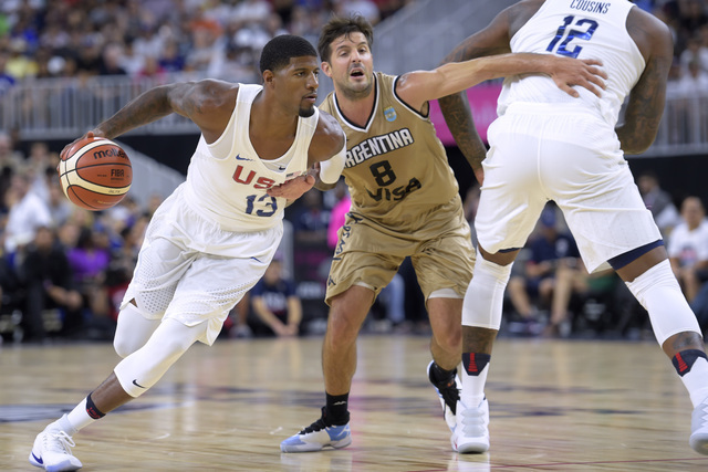 DeMarcus Cousins, right,  of the United States sets a pick on Nicolas Laprovittola of Argentina as Paul George drives to the basket during a USA Basketball showcase exhibition game at T-Mobile Are ...