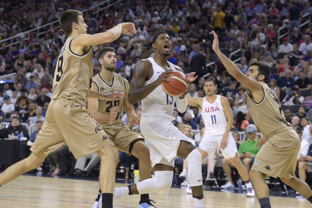 Paul George of the United States drives through the Argentina defense during a USA Basketball showcase exhibition game at T-Mobile Arena. (Sam Morris/Las Vegas News Bureau)
