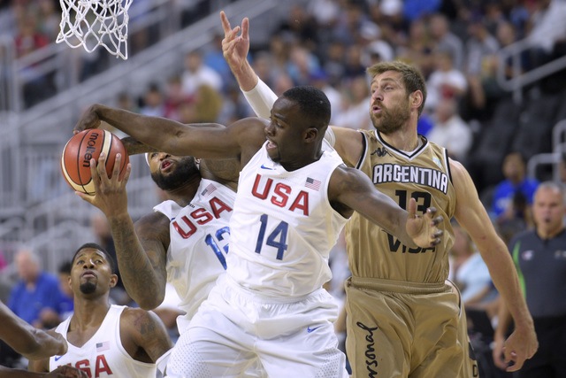 DeMarcus Cousins, left, and Draymond Green of the United States grab a rebound from Andres Nocioni of Argentina during a USA Basketball showcase exhibition game at T-Mobile Arena. (Sam Morris/Las  ...