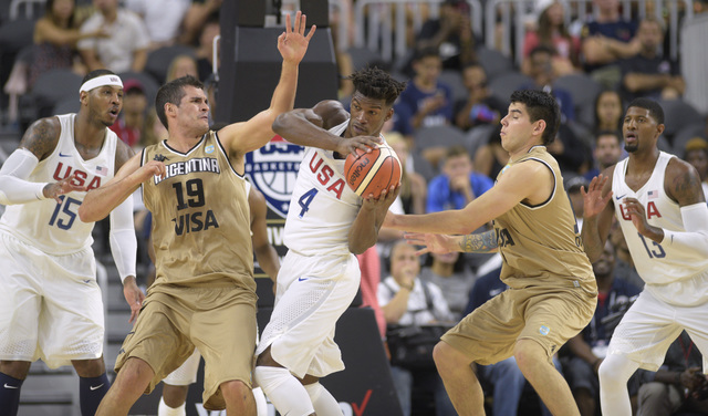 Jimmy Butler of the United States is defended by Leonardo Mainoldi, left, and Gabriel Deck of Argentina during a USA Basketball showcase exhibition game at T-Mobile Arena. (Sam Morris/Las Vegas Ne ...