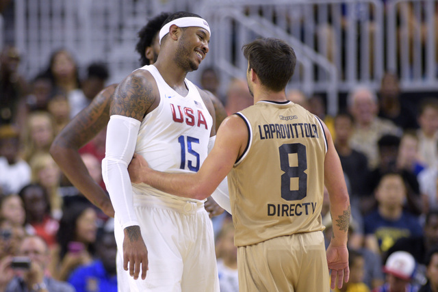 Carmelo Antony of the United States and Nicolas Laprovittola of Argentina share a laugh during a USA Basketball showcase exhibition game at T-Mobile Arena Friday, July 22, 2016, in Las Vegas, Neva ...