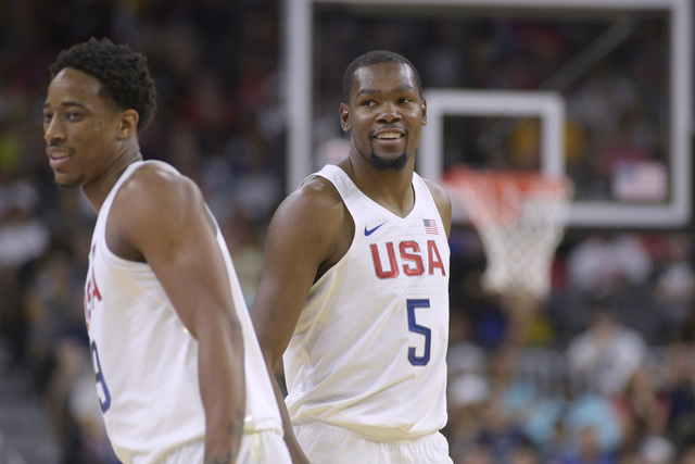Harrison Barnes, left, and Kevin Durant of the United States smile during a USA Basketball showcase exhibition game against Argentina at T-Mobile Arena . (Sam Morris/Las Vegas News Bureau)