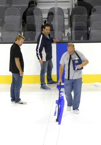 The first blue line for hockey is painted as T-Mobile Arena installs ice on the venue's event floor for the first time. Saturday, July 30, 2016. CREDIT: Glenn Pinkerton/Las Vegas News Bureauu