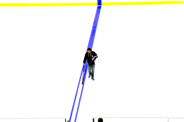 George Salami, Arena Conversion Manager paints the first blue line for hockey as T-Mobile Arena installs ice on the venue's event floor for the first time. Saturday, July 30, 2016. CREDIT:  ...