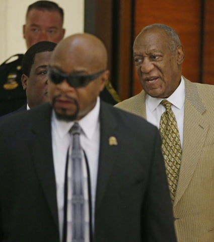 Bill Cosby, right, is surrounded by members of his security team as he walks to Courtroom A in the Montgomery County Courthouse in Norristown, Pennsylvania, July 7, 2016.  (Michael Bryant/Pool/Reu ...