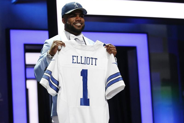 Apr 28, 2016; Chicago, IL, USA; Ezekiel Elliott (Ohio State) after being selected by the Dallas Cowboys as the number four overall pick in the first round of the 2016 NFL Draft at Auditorium Theat ...
