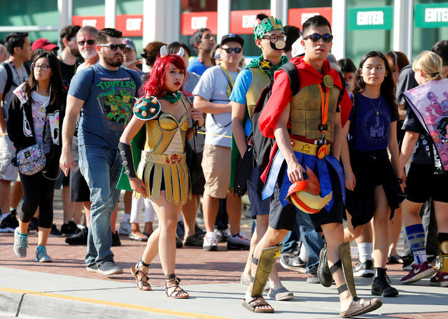 Fans of superhero movies, comic books and pop culture arrive in costume for opening day of the annual Comic-Con International in San Diego, California, United States July 21, 2016.    (Mike Blake/ ...